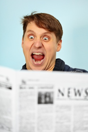 emotionality: Man shocked by bad news from the newspaper Stock Photo