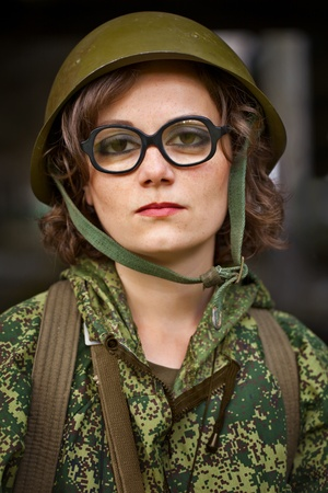 face guard: Comic portrait of a woman in military uniform