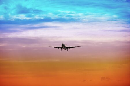 takes: A passenger plane takes off at bright sunset