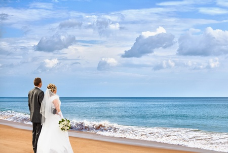 woman beach dress: The bride and groom on an ocean coast