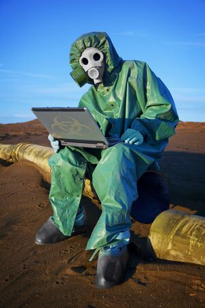 ecologist: Ecologist scientist collects data at the point of ecological disaster Stock Photo