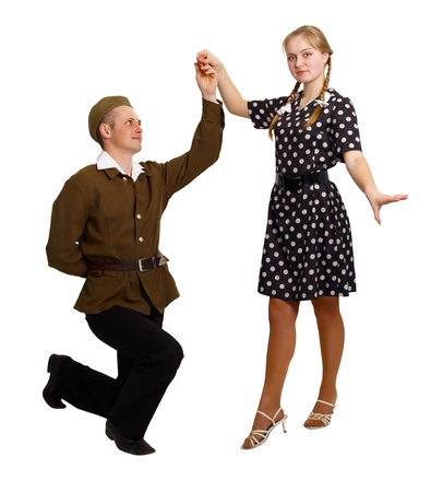 A pair of young people perform a dance in the costumes of the 60s isolated on white background photo