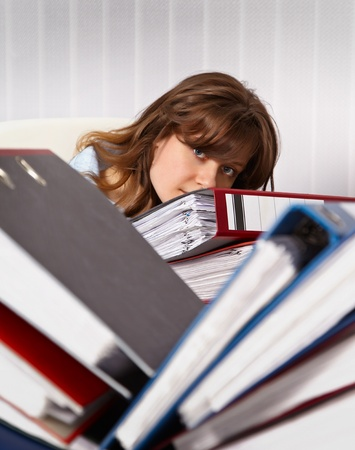 the bookkeeper: Woman secretary in the office are overworked Stock Photo