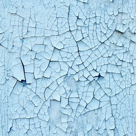 Wall covered with old enamel with a cracks - seamless texture