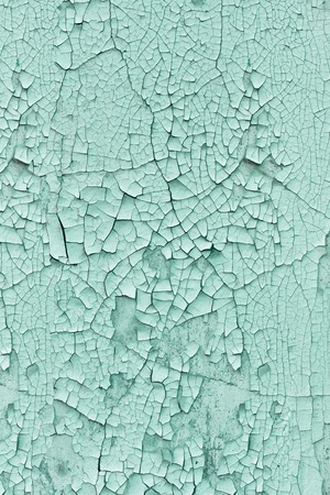 Vertical grunge background - wall covered with cracked paint