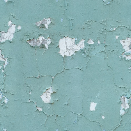 The seamless texture - cracked old blue paint on the wall photo