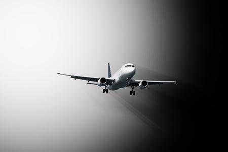 Passenger plane flies - abstract black and white composition photo