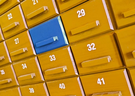 differentiate: Your individual blue wooden box in the closet