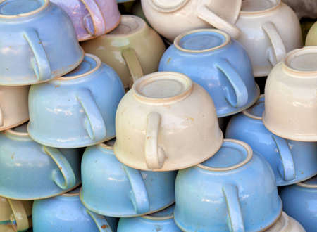 A large pile old-fashioned ceramic chamber pots on the market photo