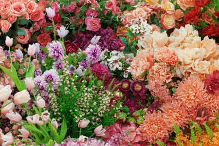 Background from a variety of artificial flowers
