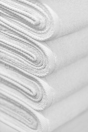 A stack of new white towels close-up - the background Stock Photo - 12295727