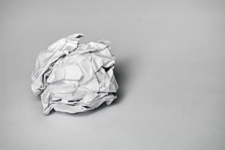 A ball of white paper on a gray background photo