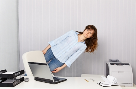 The girl - office worker goes crazy with work photo