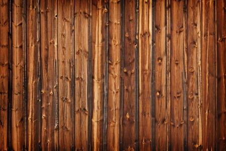 A fence made of old larch boards - grunge background photo