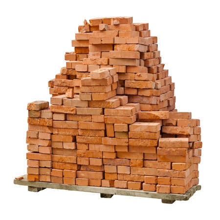 A stack of red clay bricks isolated on a white background photo