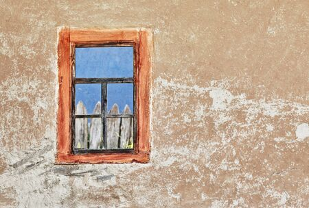 The wall of ancient Ukrainian house with a window photo