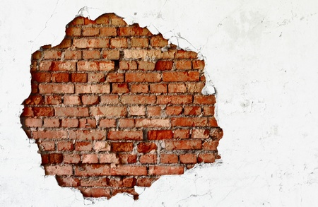 Break on the white wall - the dirty old brickwork photo