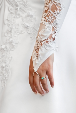 Womans hand - a wedding white glove photo