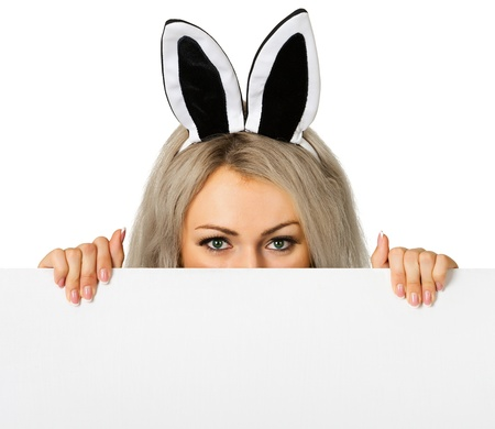 A girl dressed as a rabbit hiding behind a poster Stock Photo - 13978706