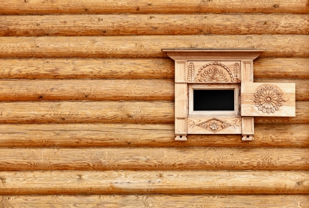Vintage wooden wall with small window - the background photo