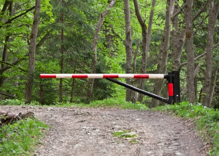 road closed: The barrier, blocking way to the forest Stock Photo