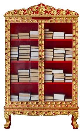 Antique gilded cabinet with Buddhist Meditation Books isolated on white photo