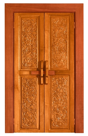 An old wooden door covered with carvings photo