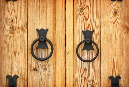 Metal handles on the old-fashioned wooden doors photo