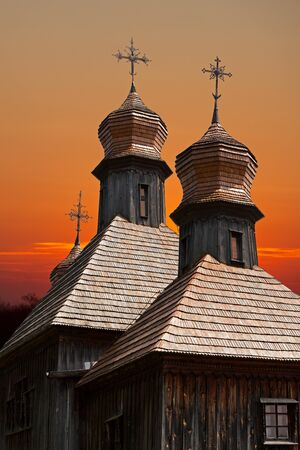 old wooden church against the evening sky photo