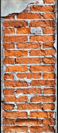 Vertical red brick old column requires repair Stock Photo - 14101600