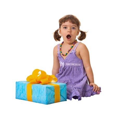 baby open present: The little girl in deep shock from a large gift Stock Photo
