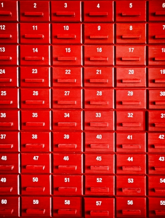 Numbered red wooden cases in the interior of Chinese temple photo