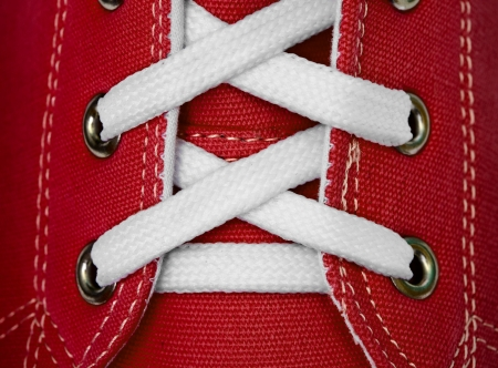 White lace on red sneakers close up Standard-Bild