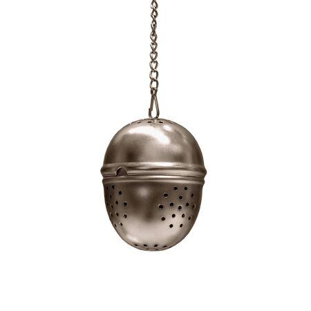 tea strainer: Metal tea infuser isolated on white background