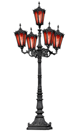 The old cast iron lamp post with red glass isolated on white background photo