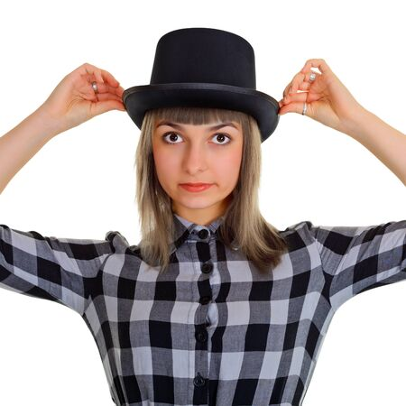 Portrait of a girl in a black silk hat, isolated on white background photo