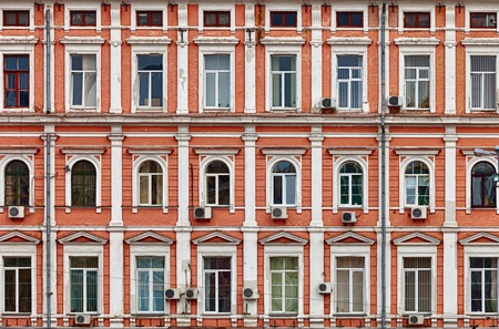 big windows: The facade of a house. The old architecture
