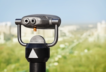 Binoculars to observe green city from a height photo
