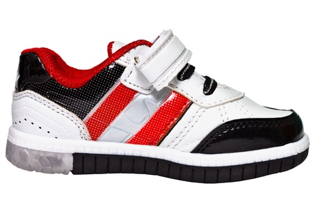 photo of object s: Chinese sneaker with red stripes isolated on white background