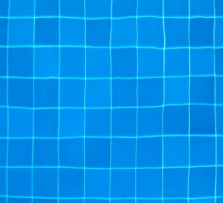 Blue tiles at the bottom of a swimming pool - abstract background Stock Photo