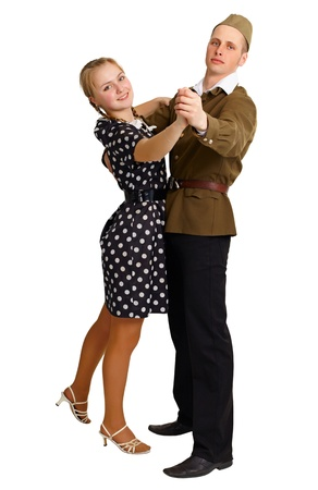 A pair in clothes 40th years dancing isolated on white background photo