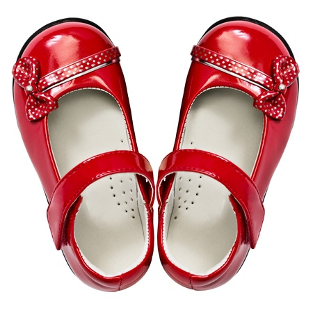 Baby red shoes isolated on white background