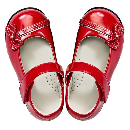 Baby-Schuhe rot auf weißem Hintergrund