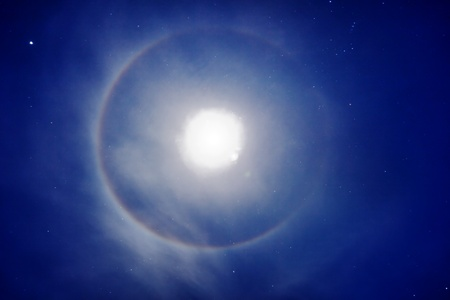 The halo around the moon - night photo photo