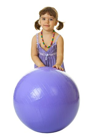 Little girl with a large rubber ball isolated on white background photo