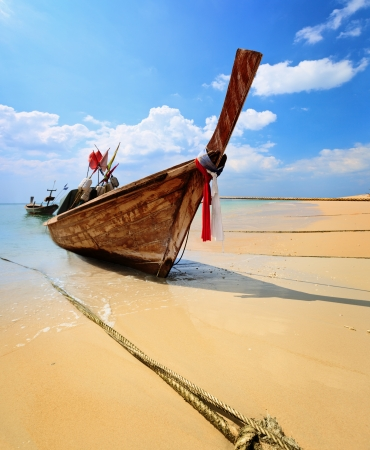 Traditional Thai longtail boat on the beach - Phuket photo