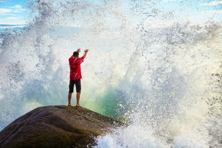 A young man prays sea elements Standard-Bild