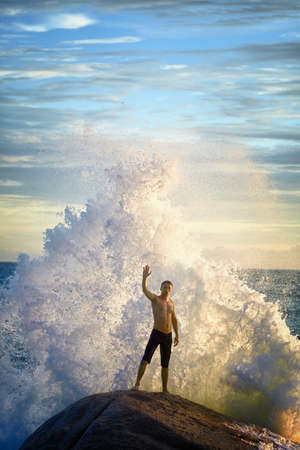 standing water: A young man like a god of the sea commands the elements