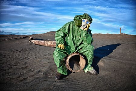 Man in protective clothing in the area of environmental disaster Stock Photo - 14547899