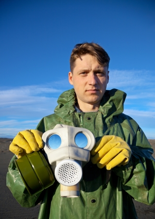 A man in a overalls with a mask in his hands Stock Photo - 14547896